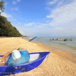 Blue boat in the sand at suanson in Rayong