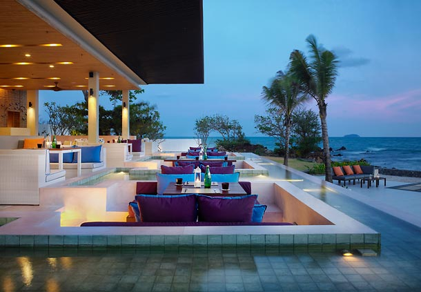 Scenic restaurant setting next to pool and tropical beach